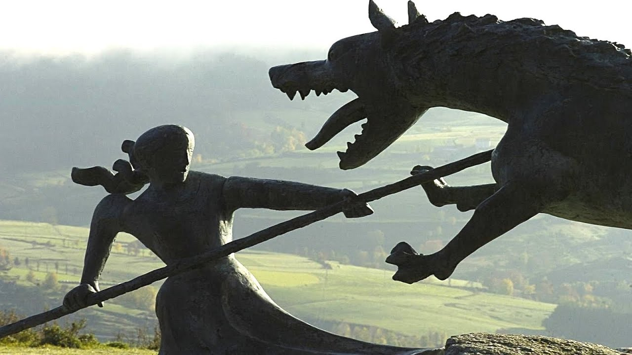A photograph of a statue of a knight slaying the Beast of Gevadaun
